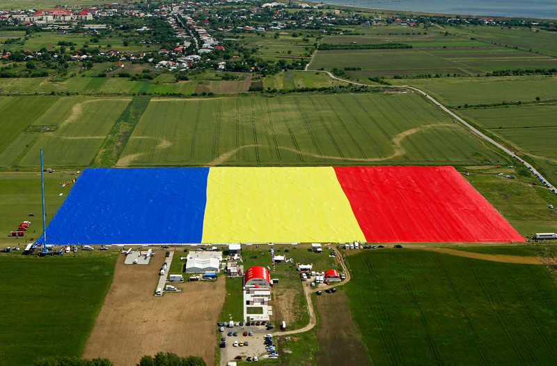. An aerial view of Romania\'s national flag during a Guinness World Record attempt for the world\'s biggest national flag in Clinceni, near Bucharest May 27, 2013.  The flag, measuring 349.4 per 226.9 meters, established a new Guinness World Record, according to the organization\'s officials. REUTERS/Bogdan Cristel