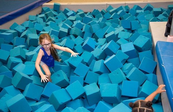 08/22/19 Wesley Bunnell | Staff The New Britain YWCA held an open house on Thursday August 22, 2019 to showcase the programs and benefits for prospective members by having them visit scavenger hunt stations each with a different theme. Payton Castiglione makes her way through the foam landing pit at the gymnastics station.