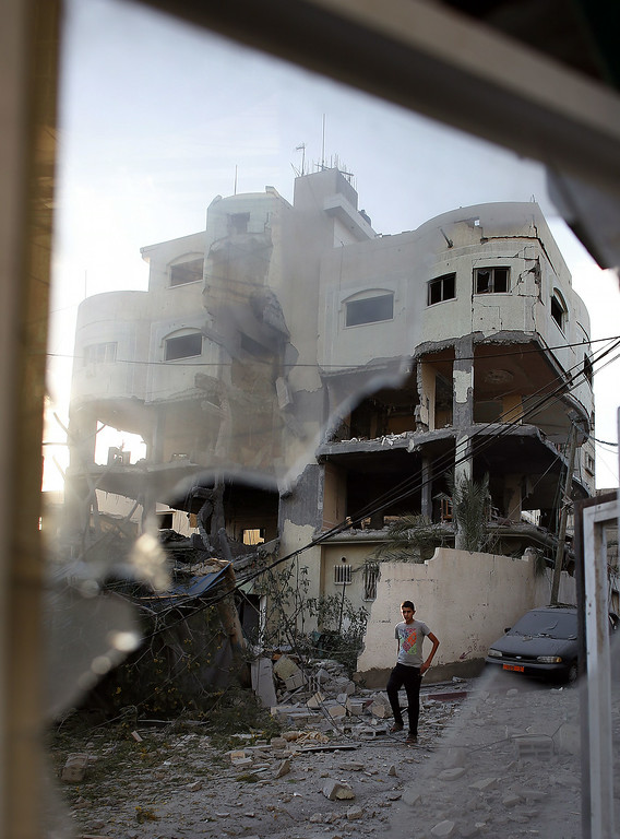 . A Palestinian man walks past the house of senior Hamas official Mahmud al-Zahar after it was destroyed by an overnight Israeli air strike, on July 16, 2014, in Gaza City. New Israeli air and tank strikes in Gaza early today killed several people, medics said, bringing the death toll from Israel\'s operation in the besieged Palestinian territory to 204. AFP PHOTO / THOMAS COEX/AFP/Getty Images