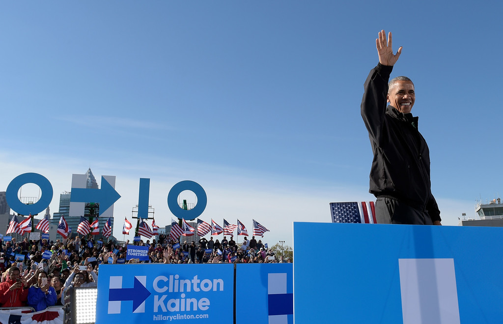 . President Barack Obama arrives to speak at a campaign rally for Democratic presidential candidate Hillary Clinton, Friday, Oct. 14, 2016, at the Cleveland Burke Lakefront Airport in Cleveland, Ohio. (AP Photo/Susan Walsh)
