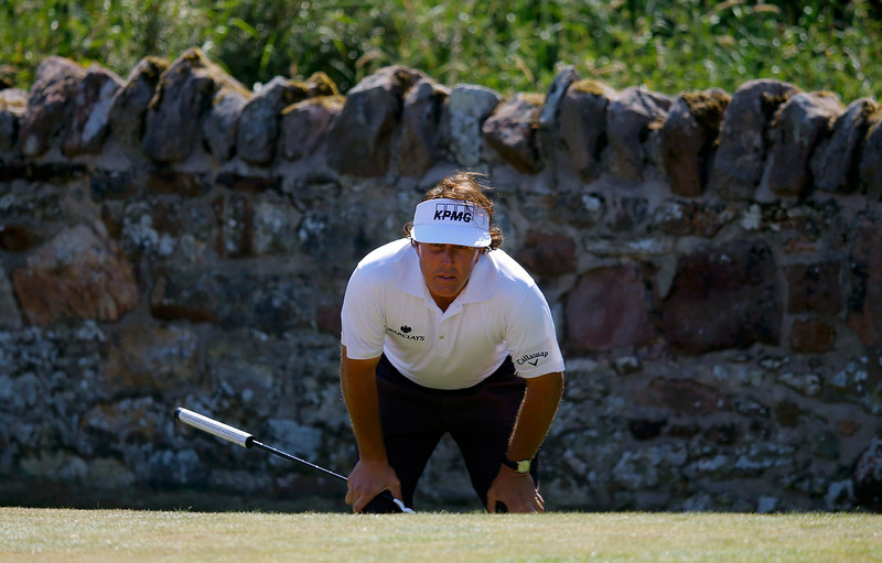 . Phil Mickelson of the U.S. lines up his putt on the second green during the second round of the British Open golf championship at Muirfield in Scotland July 19, 2013.   REUTERS/Brian Snyder