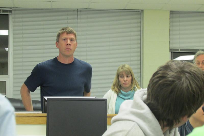 Alan Gilgenbach gives feed back during closing meeting