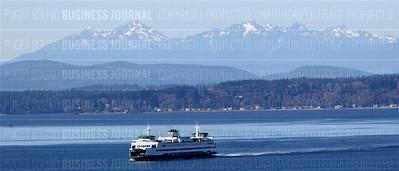 A Washington State ferry sails into Colman Dock in Elliott Bay, Seattle, Washington as seen on March 3, 2015.