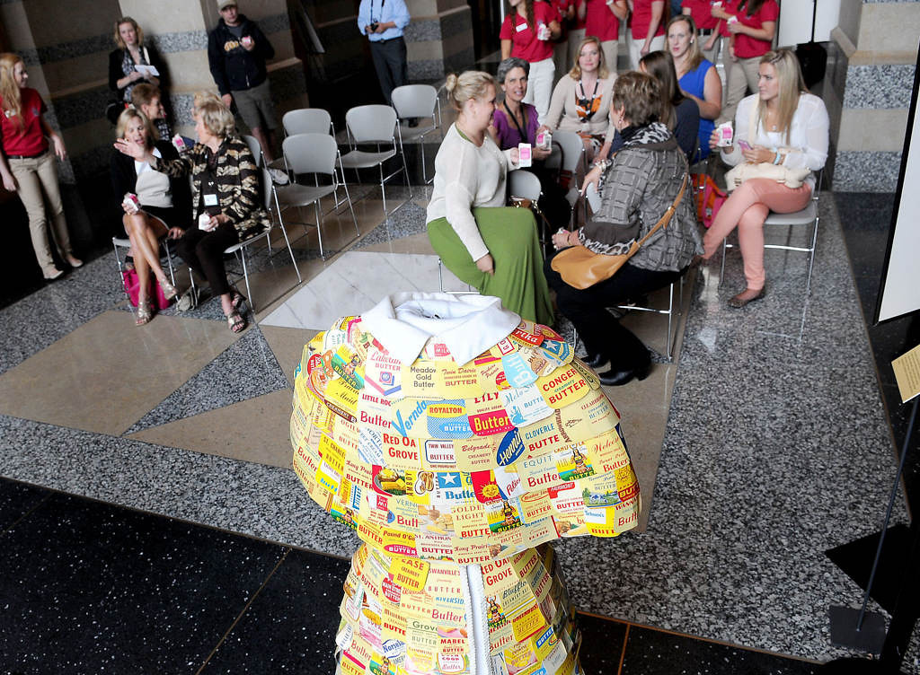 . Princess Kays past, present and future drink milk as they gathered for a ceremony at the Minnesota History Center on Saturday July 27, 2013, to honor the history of Princess Kay of the Milky Way and to start the countdown to crowning the 60th Kay on Aug. 21. The original butter carton dress worn at the 1965 Minnesota State Fair by Princess Kay Mary Ann Titrud was on display, foreground.   (Pioneer Press: Sherri LaRose-Chiglo)