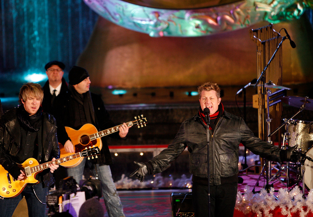 . Lead singer Gary LeVox, right, and Rascal Flatts perform during the 76th annual Rockefeller Center Christmas tree lighting ceremony Wednesday, Dec. 3, 2008, in New York.  (AP Photo/Jason DeCrow)