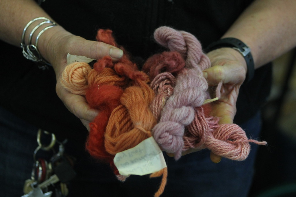 . A plant dyes demonstration during the Farmpark\'s sheep shearing weekend showed visitors how the fleece after being sheared and spun into yarn could be dyed an assortment of colors using plants. Kristi Garabrandt- The News-Herald