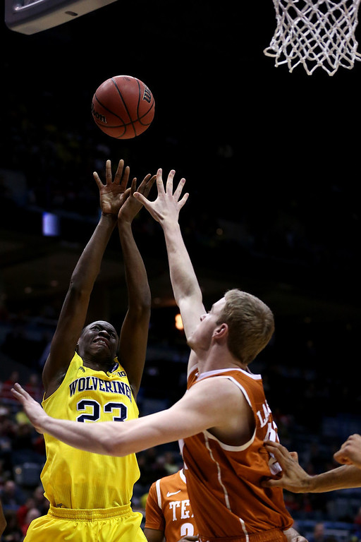 . Caris LeVert #23 of the Michigan Wolverines shoots the ball against the Texas Longhorns during the third round of the 2014 NCAA Men\'s Basketball Tournament at BMO Harris Bradley Center on March 22, 2014 in Milwaukee, Wisconsin.  (Photo by Jonathan Daniel/Getty Images)
