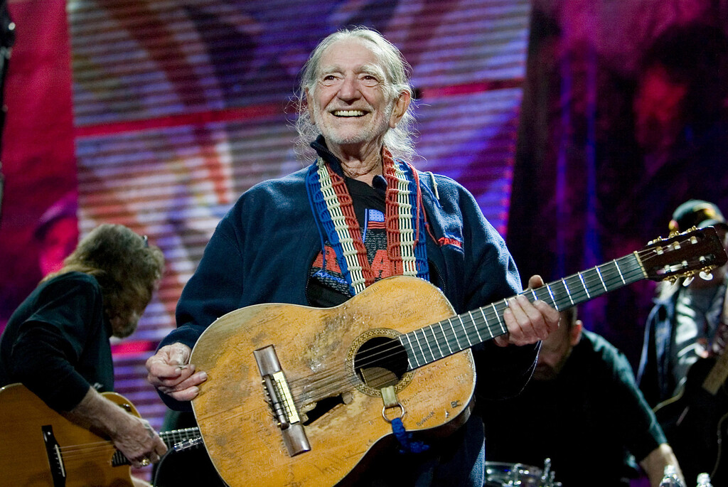 . Willie Nelson entertains the audience while performing at the Farm Aid Concert in Camden, N.J. on Saturday, Sept. 30, 2006. (AP Photo/Tim Larsen)