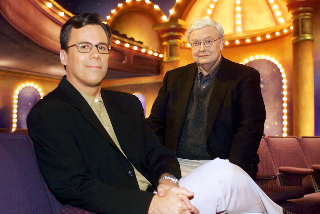""". Chicago Sun-Times columnist Richard Roeper, left, sits with Sun-Times film critic Roger Ebert on the set of the newly named \""""Ebert & Roeper and The Movies\"""" Wednesday, July 12, 2000, in Chicago. (AP Photo/Fred Jewell)"""