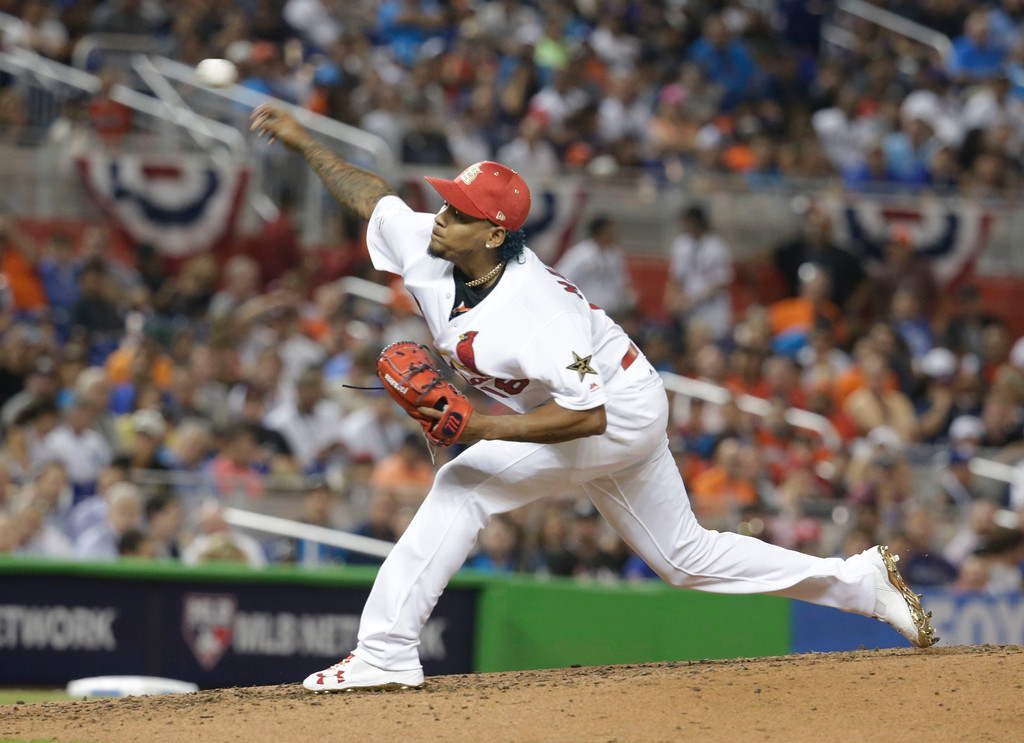 . National League\'s St. Louis Cardinals pitcher Carlos Martĺnez (18), delivers a pitch, during the third inning at the MLB baseball All-Star Game, Tuesday, July 11, 2017, in Miami. (AP Photo/Lynne Sladky)