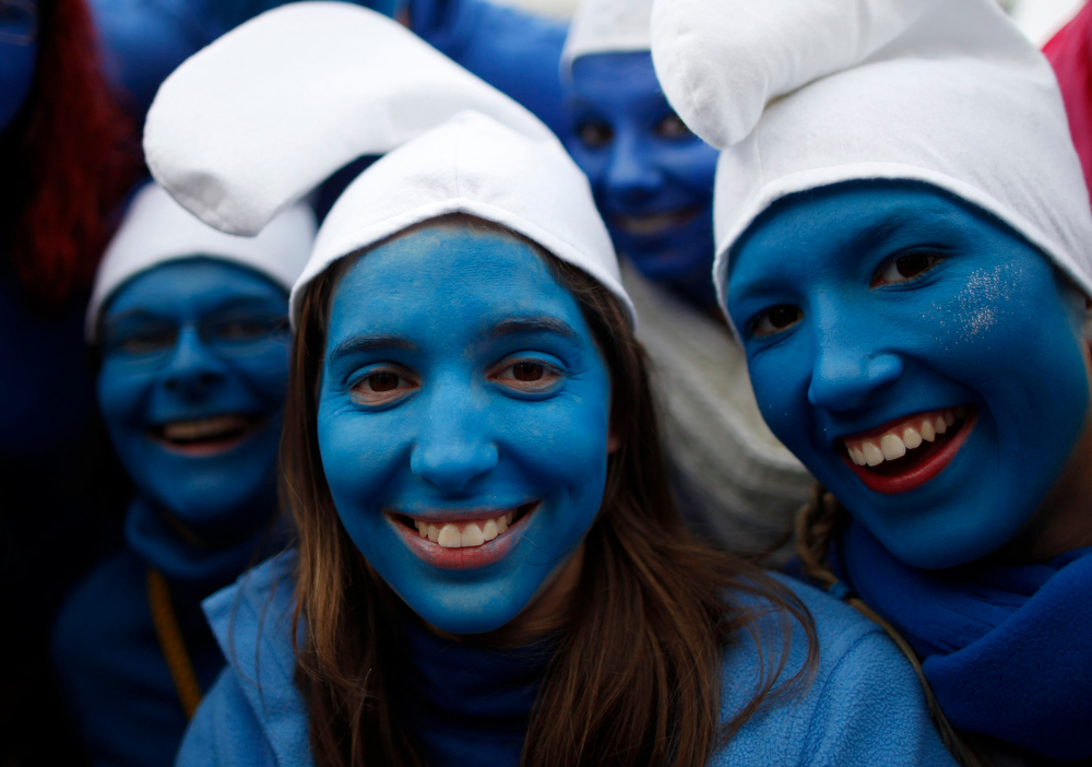 """Description of . Women dressed as Smurfs celebrate \""""Weiberfastnacht\"""" (Women\'s Carnival) in Cologne February 7, 2013. Women\'s Carnival marks the start of a week of street festivals, the highlight of the event being \""""Rosenmontag\"""" (Rose Monday), the final day of the carnival where mass processions are held. REUTERS/Ina Fassbender"""