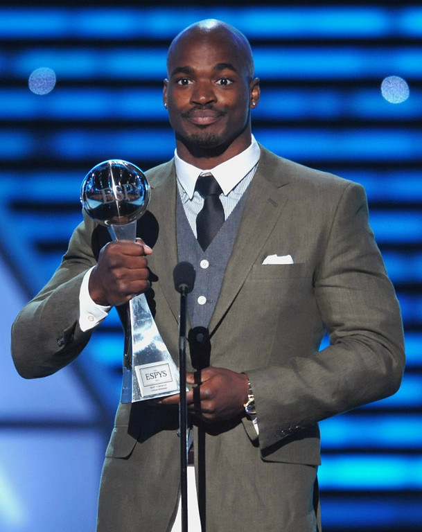 . Adrian Peterson accepts the award for best comeback at the ESPY Awards on Wednesday, July 17, 2013, at Nokia Theater in Los Angeles. (Photo by John Shearer/Invision/AP)