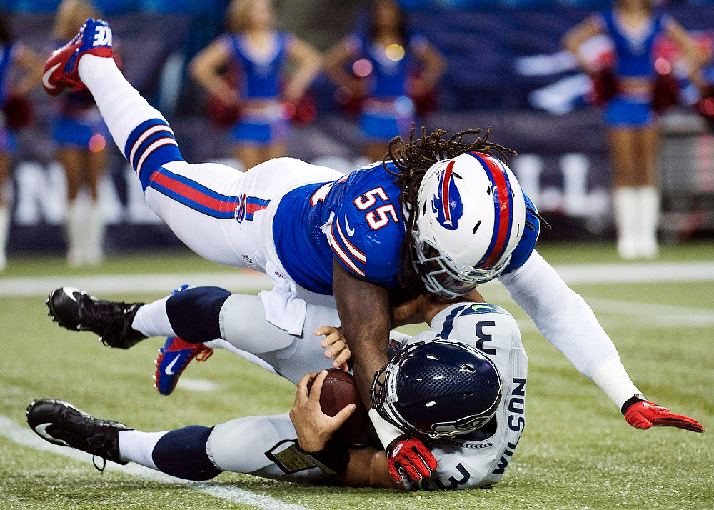 . Buffalo Bills linebacker Kelvin Sheppard (55) sacks Seattle Seahawks quarterback Russell Wilson (3) during the first the half of an NFL football game in Toronto, Sunday, Dec. 16, 2012. (AP Photo/The Canadian Press, Nathan Denette)