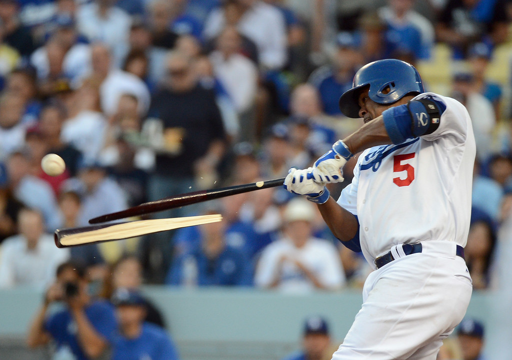 . Los Angeles Dodgers\' Juan Uribe breaks his bat as he lined out to second in the second inning during game 4 of the NLCS at Dodger Stadium Tuesday, October 15, 2013. (Photo by David Crane/Los Angeles Daily News)