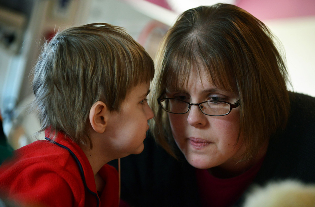 . Cameron Ulrich whispers to his mom Kari that he\'d like a cheese sandwich brought to his room in the cardiovascular intensive care wing of St. Mary\'s Hospital in Rochester.   (Pioneer Press: Richard Marshall)