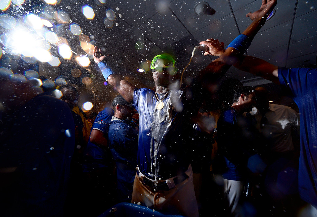 . The Los Angeles Dodgers\' Yasiel Puig celebrates winning the NLDS title with his team in Dodger Stadium\'s club house Monday night, October 7, 2013. Dodgers defeated the Atlanta Braves 4-3 in the fourth game. (Photo by Sarah Reingewirtz/Los Angeles Daily News)