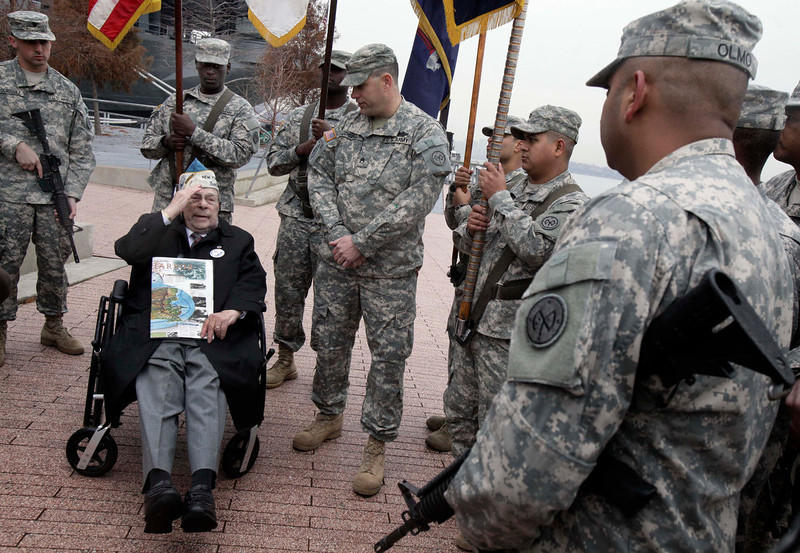 . Pearl Harbor survivor Daniel Fruchter, of Eastchester, N.Y., salutes members of the color guard during a visit before ceremonies at the Intrepid Sea, Air and Space Museum. in New York, commemorating the 71st anniversary of the attack at Pearl Harbor, Friday, Dec. 7, 2012. President Barack Obama marked the day on Thursday by issuing a presidential proclamation, calling for flags to fly at half-staff on Friday and asking all Americans to observe the day of remembrance and honor military service members and veterans. (AP Photo/Richard Drew)