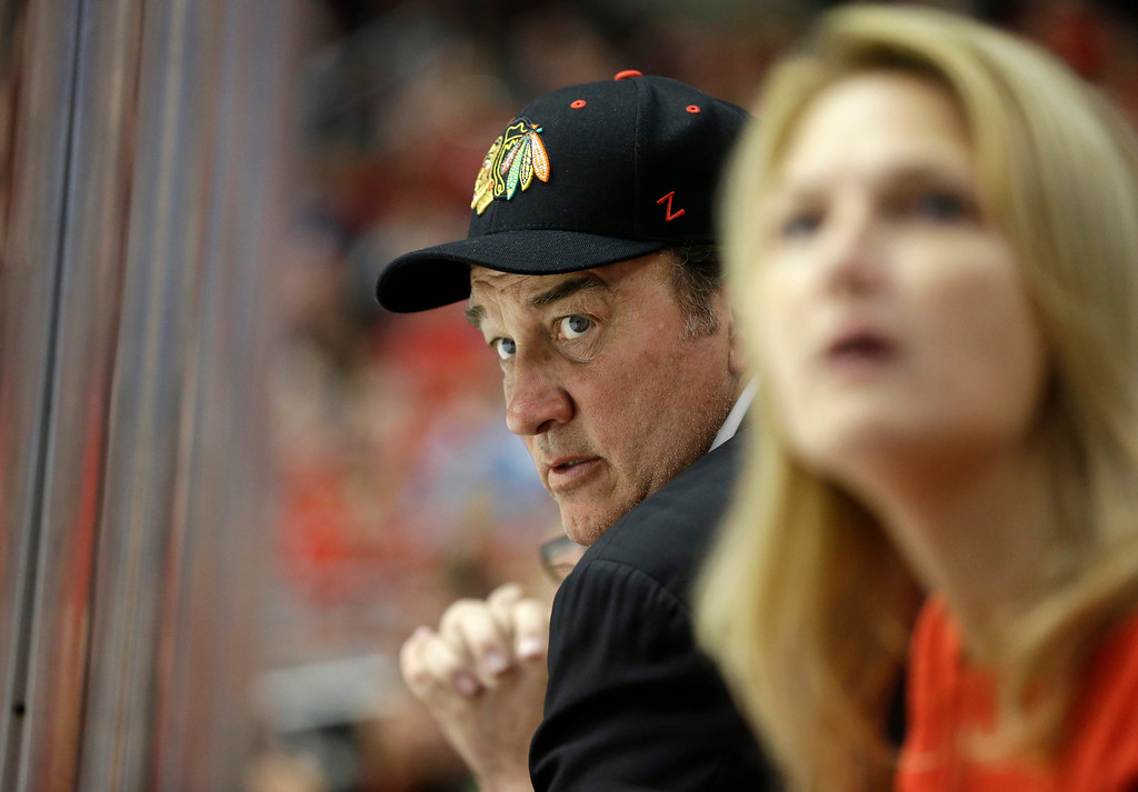 . Actor Jim Belushi watches during the first period of Game 1 in their NHL Stanley Cup Final hockey series between the Chicago Blackhawks and the Boston Bruins, Wednesday, June 12, 2013, in Chicago. (AP Photo/Nam Y. Huh)