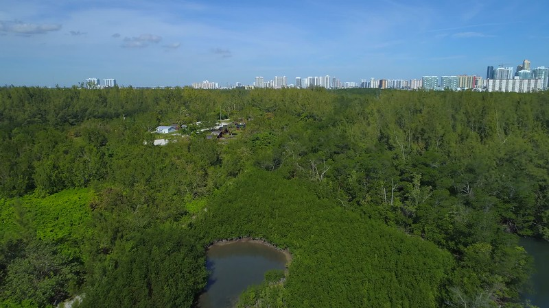 Aerial stock footage log cabin campground Oleta Park Miami