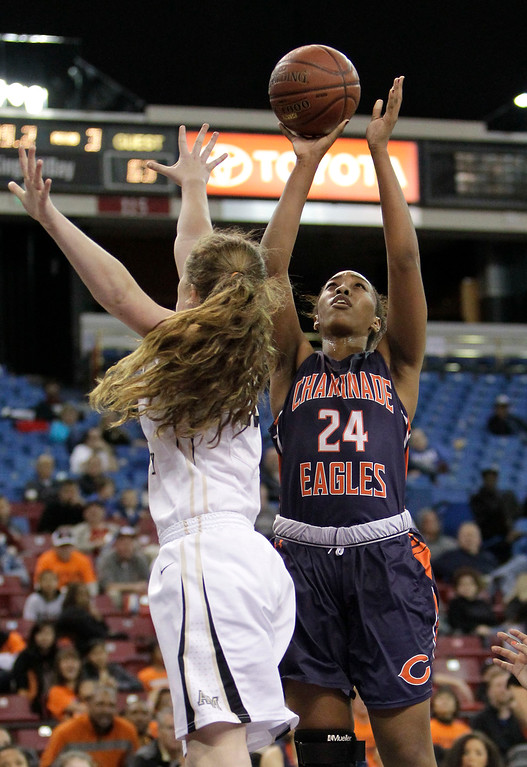 . Chaminade center Devin Stanback, right, shoots against Archbishop Mitty guard Madeline Holland during the second half of the girls\' Division 2 CIF basketball championship game Saturday, March 29, 2014, in Sacramento, Calif.  Chaminade won 85-51.(AP Photo/Rich Pedroncelli)