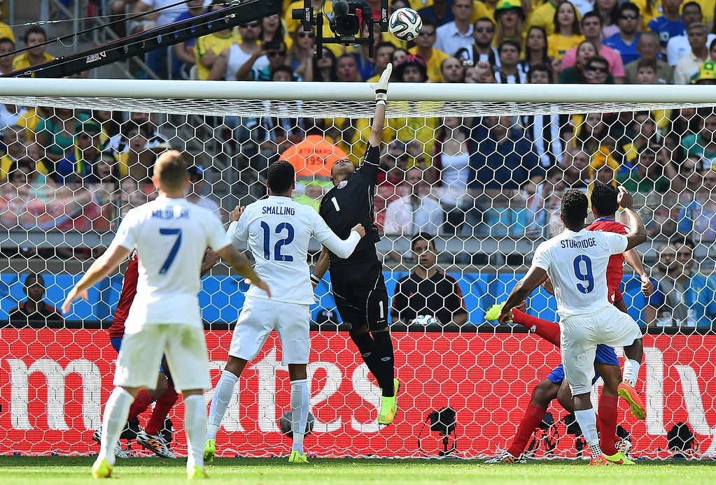 . Costa Rica\'s goalkeeper Keylor Navas (C) makes a save from England\'s defender Chris Smalling (2L) and England\'s forward Daniel Sturridge (R) during the Group D football match between Costa Rica and England at The Mineirao Stadium in Belo Horizonte on June 24, 2014,during the 2014 FIFA World Cup .  BEN STANSALL/AFP/Getty Images