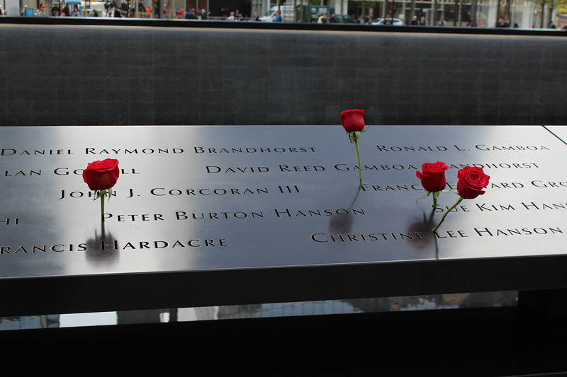 S. Tower reflecting pool with names and flowers.JPG