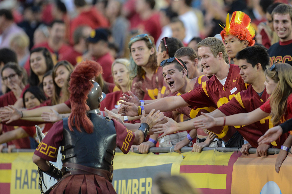 . USC fans greet the mascot Saturday.  USC defeated Colorado 50-6.  (10/20/12) Photo by David Crane/L.A. Daily News