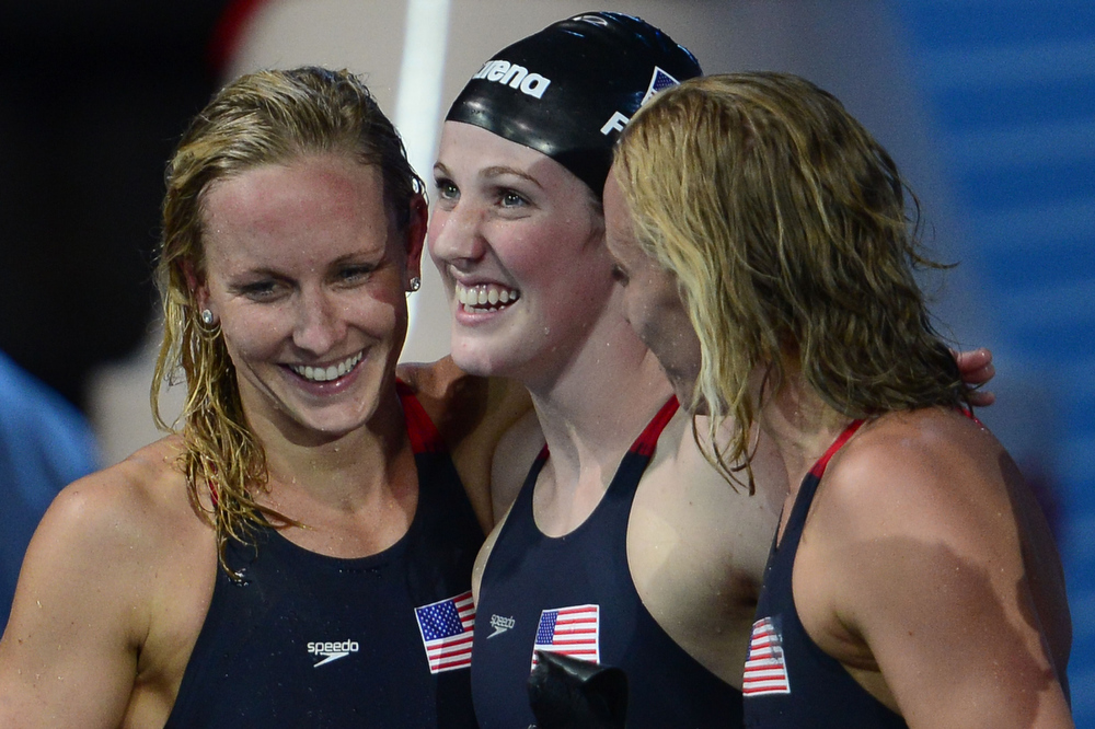 . (From L) US swimmers Jessica Hardy, Missy Franklin and Dana Vollmer celebrate after winning the final of the women\'s 4x100-metre medley relay swimming event in the FINA World Championships at Palau Sant Jordi in Barcelona on August 4, 2013.  JAVIER SORIANO/AFP/Getty Images