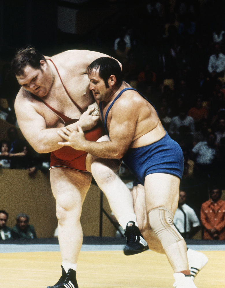 Description of . Chris Taylor, USA, left, overwhelms Wilfred Dietrich, West Germany, in their Olympic Heavyweight Wrestling match at the 1972 Summer Olympics in Munich, Germany, Aug. 1972. (AP Photo)