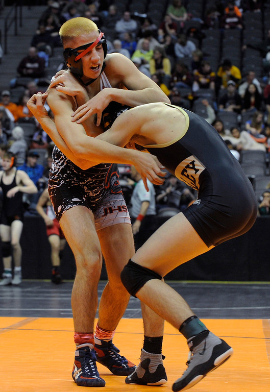 . DENVER, CO. - FEBRUARY 21: Jefferson High School senior Jacob Cisneros, top, struggled with his headgear as he faced off against Valley\'s Jackson Wright, right, in a 152-pound bout in class 3A Thursday. The CHSAA State Wrestling Tournament kicked off Thursday, February 21, 2013 at the Pepsi Center in Denver.    (Photo By Karl Gehring/The Denver Post)