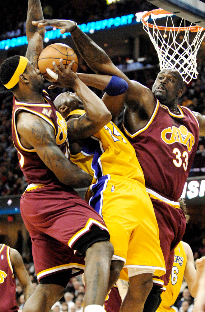 . Jeff Forman/JForman@News-Herald.com Kobe Bryant is fouled by Shaquille O\'Neal as O\'Neal and LeBron James cover Bryant near the end of the first half Thursday at Quicken Loans Arena.