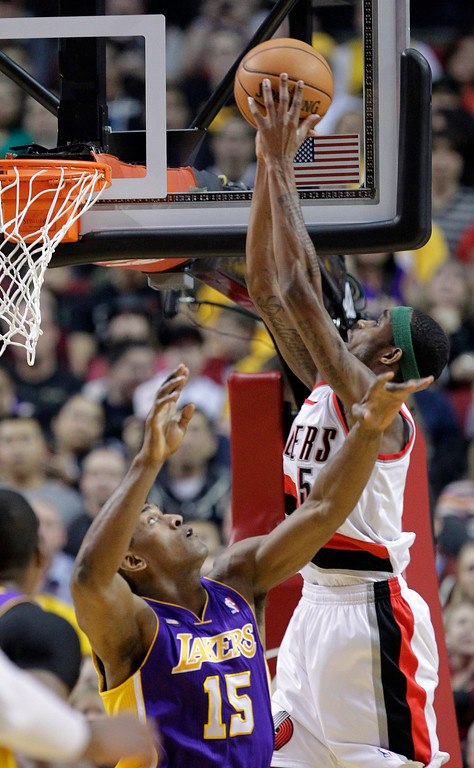 . Portland Trail Blazers guard Will Barton, right, shoots over Los Angeles Lakers forward Metta World Peace during the first half of an NBA basketball game in Portland, Ore., Wednesday, April 10, 2013.(AP Photo/Don Ryan)