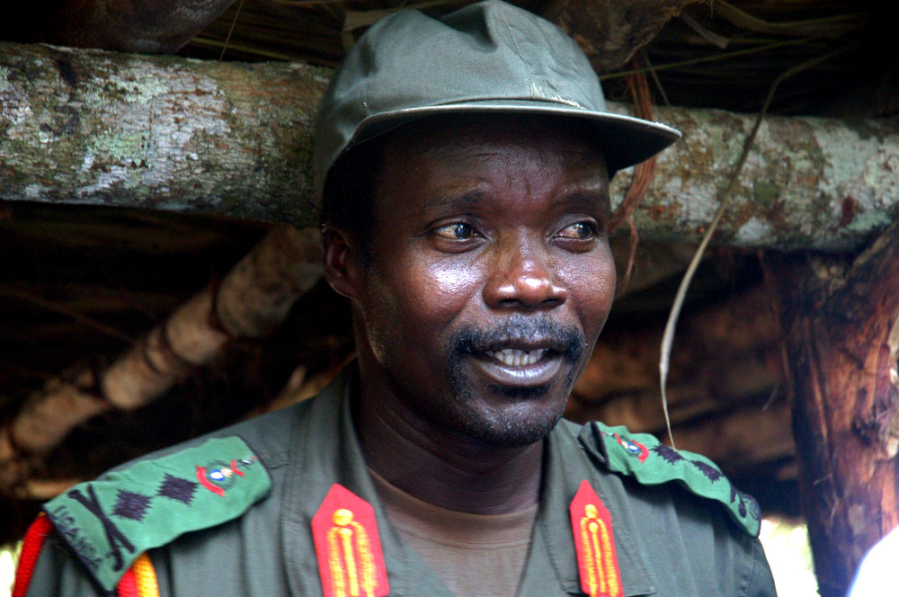 Description of . This July 31, 2006 file photo shows Joseph Kony, leader of the Lord's Resistance Army, during a meeting with a delegation of 160 officials and lawmakers from northern Uganda and representatives of non-governmental organizations in Congo near the Sudan border. An activist group based in Southern California is getting worldwide attention for a video that documents wartime atrocities in Africa. The film released Monday, March 7, 2012 is part of an effort called KONY 2012. It targets the Lord's Resistance Army and its leader, Joseph Kony, a bush fighter wanted by the International Criminal Court for crimes against humanity. Joseph Kony ranked as Google's nineth most searched trending person of 2012. (AP Photo, File)