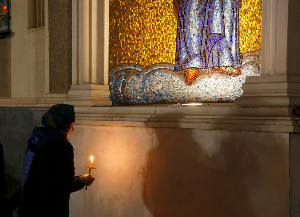 . An Orthodox devotee prays during Easter Sunday rites in Donetsk, Ukraine, early Sunday, April 20, 2014.  (AP Photo/Sergei Grits)
