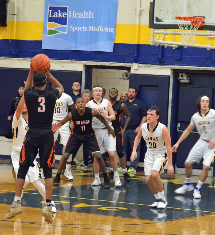 . Paul DiCicco - The News-Herald Orange�s Jalen Warren takes a 3-pointer that proved to be the game-winner late in the fourth quarter against Wickliffe.