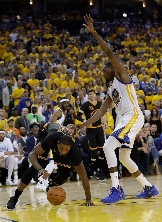 . Cleveland Cavaliers center Tristan Thompson, left, is defended by Golden State Warriors forward Kevin Durant during the second half of Game 2 of basketball\'s NBA Finals in Oakland, Calif., Sunday, June 4, 2017. (AP Photo/Marcio Jose Sanchez)