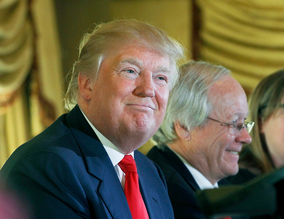 . Donald Trump, left, appears with Bill Swank of the Palos Verdes Peninsula Land Conservancy at a news conference during an announcement regarding his Trump National Golf Club Los Angeles in Rancho Palos Verdes, Calif., Thursday, Jan. 15, 2015. (AP Photo/Nick Ut)