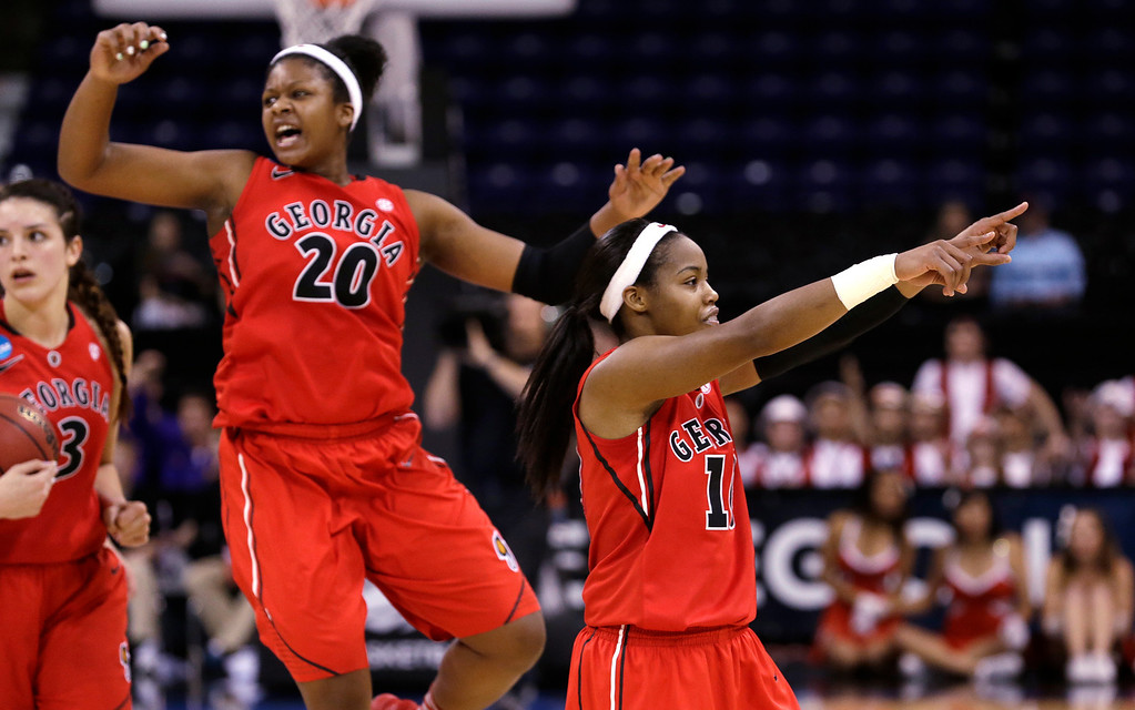 . Georgia\'s Jasmine James, right, motions to fans as Shacobia Barbee (20) celebrates in the final seconds against Stanford in a regional semifinal in the NCAA women\'s college basketball tournament Saturday, March 30, 2013, in Spokane, Wash. Georgia won 61-59. (AP Photo/Elaine Thompson)