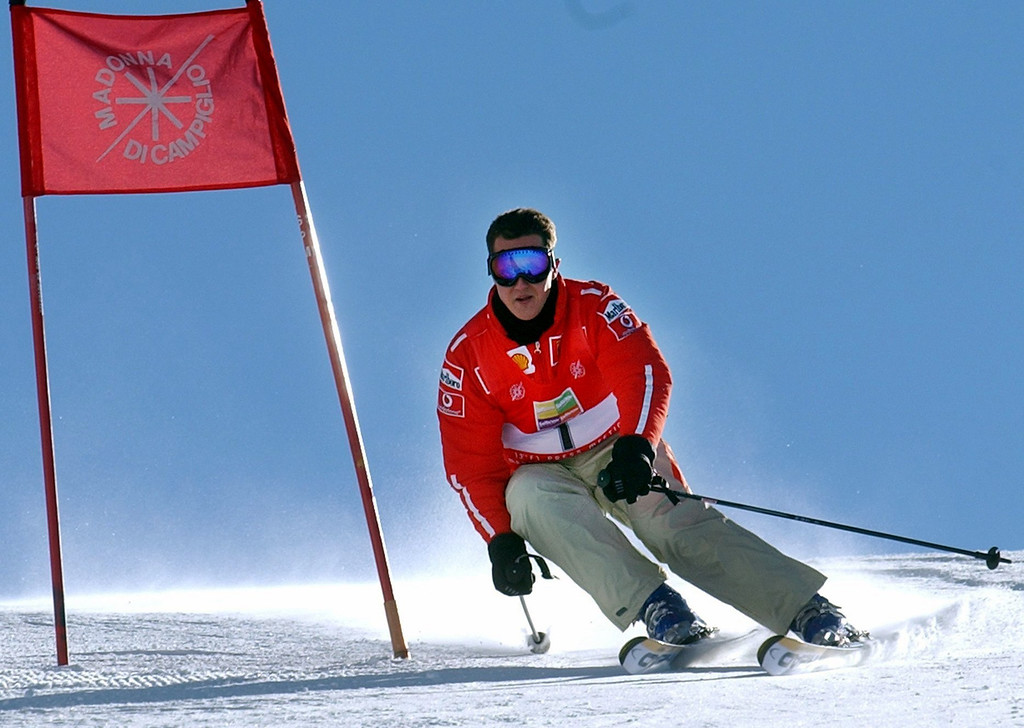. (dpa) - German formula 1 pilot Michael Schumacher races down a hill on his skis during the traditional three-day Ferrari meeting in Madonna di Campiglio, Italy, 17 January 2003. Photo by: Oliver Multhaup/picture-alliance/dpa/AP Images