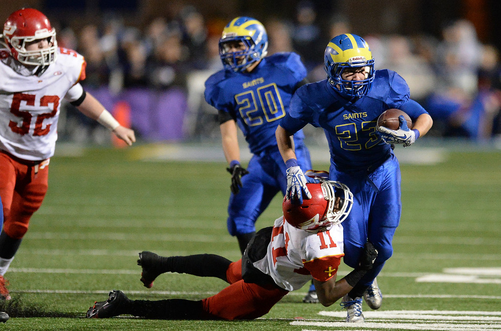 . San Dimas\' Joseph Mayorga (23) runs for a first down as Paraclete\'s Melquise Stovall makes the tackle in the second half of a CIF-SS Mid-Valley Division championship football game at San Dimas High School in San Dimas, Calif., on Friday, Dec. 6, 2013. San Dimas won 20-14.  (Keith Birmingham Pasadena Star-News)
