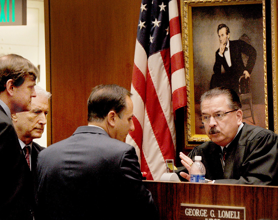 . Attorneys Brad Bailey, Jeffrey Denner, and prosecutor Habib Balian in conference with judge George Lomeli in the Christian Karl Gerhartsreiter murder trial at Clara Shortridge Foltz Criminal Justice Center in Los Angeles Thursday, March 28, 2013. Cerhartsreiter has pleaded not guilty to the killing of John Sohus, 27, who disappeared with his wife, Linda, in 1985 while Gerhartsreiter was a guest cottage tenant at the home of Sohus\' mother, where the couple lived. (Photo by Walt Mancini/SGVN)