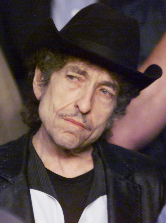 . Bob Dylan watches from ringside prior to the start of the Felix Trinidad-William Joppy WBA Middleweight Championship bout at Madison Square Garden in New York Saturday, May 12, 2001.  (AP Photo/Jeff Zelevansky)