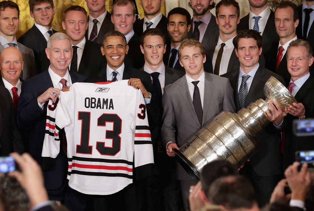 . President Barack Obama (3rd L front row) poses for photographs with the National Hockey League 2013 champion Chicago Blackhawks (front row L-R) Executive Vice President Jay Blunk, President and CEO John McDonough, forward Jonathan Toews, forward Patrick Kane, forward Patrick Sharp and Assistant Coach Mike Kitchen in the East Room of the White House November 4, 2013 in Washington, DC. This is the second visit to the White House in as many years for the Blackhawks, who won the Stanley Cup in 2010.  (Photo by Chip Somodevilla/Getty Images)