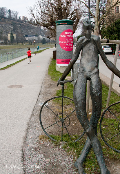 Statue by the river in Salzburg