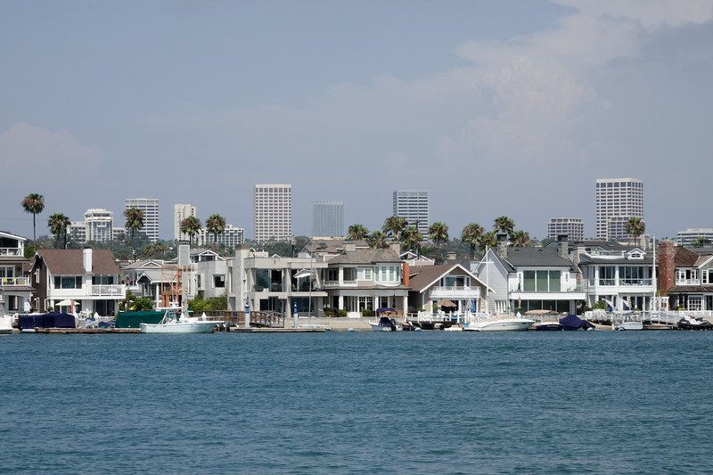View of Balboa Island from the Balboa Ferry, with the city of Newport Beach behind it.