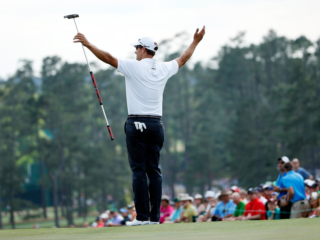 . Defending Masters champion Adam Scott, of Australia, acknowledges applause on the 18th green following his fourth round of the Masters golf tournament Sunday, April 13, 2014, in Augusta, Ga. (AP Photo/Matt Slocum)