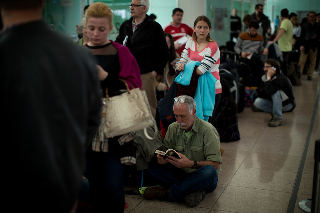 . Passengers who have had their flight to Brussels canceled wait at the Barcelona airport, Spain, on Tuesday, March 22, 2016.  Explosions, at least one likely caused by a suicide bomber, rocked the Brussels airport and subway system Tuesday, prompting a lockdown of the Belgian capital and heightened security across Europe. (AP Photo/Emilio Morenatti)