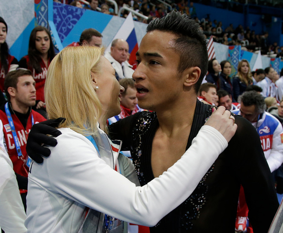 . Florent Amodio of France, right, is embraced by a team member after he competed in the men\'s team short program figure skating competition at the Iceberg Skating Palace during the 2014 Winter Olympics, Thursday, Feb. 6, 2014, in Sochi, Russia. (AP Photo/Darron Cummings, Pool)