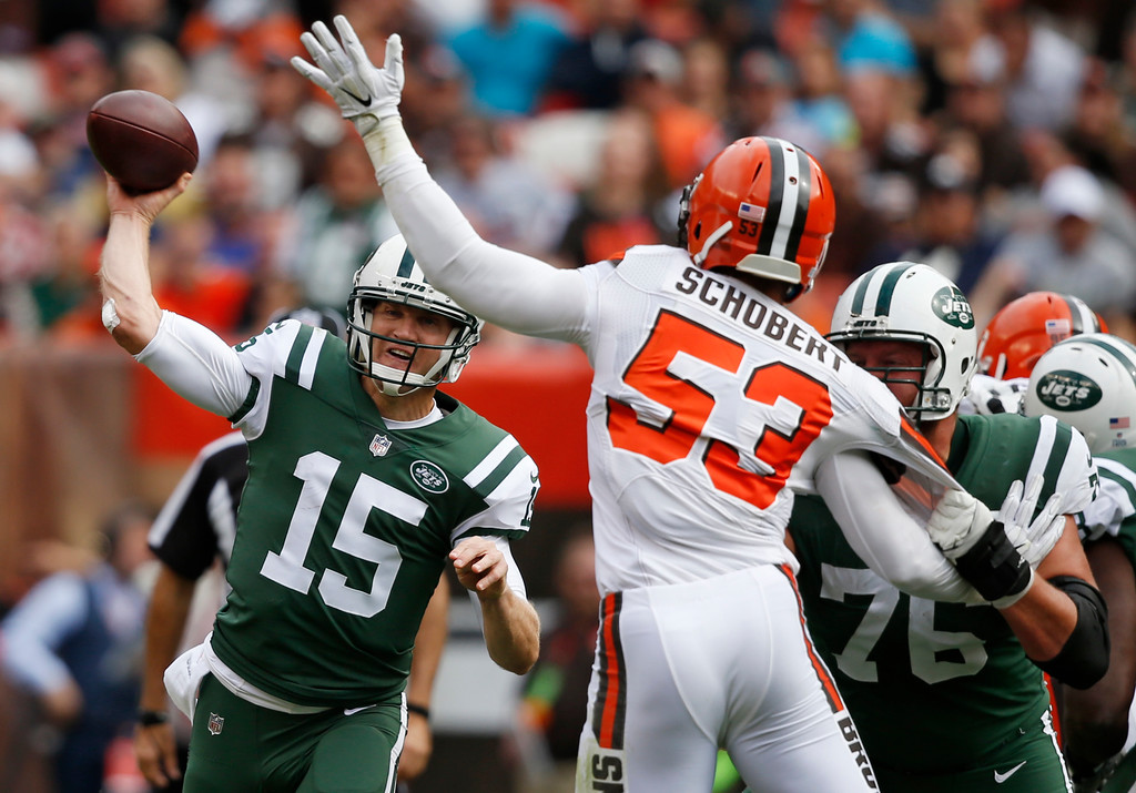 . New York Jets quarterback Josh McCown (15) passes against Cleveland Browns outside linebacker Joe Schobert (53) during the first half of an NFL football game, Sunday, Oct. 8, 2017, in Cleveland. (AP Photo/Ron Schwane)