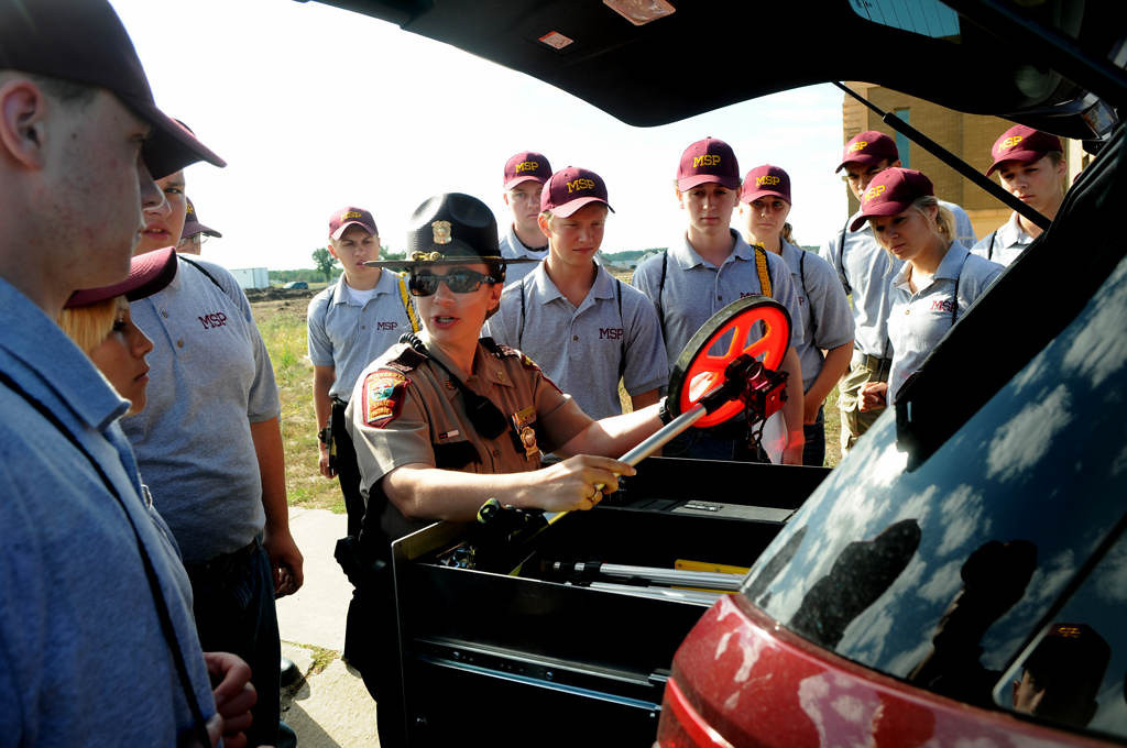 . Minnesota State Patrol Tech Sergeant Kelly Phillips shows cadets everything she keeps in her patrol car. (Pioneer Press: Jean Pieri)